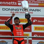 Scott does the treble at Donington